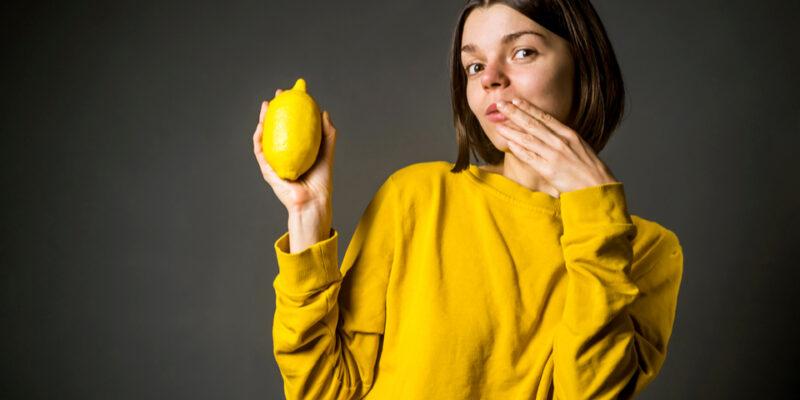 A girl holding a lemon
